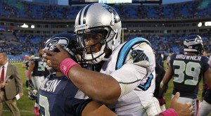 Carolina Panthers' Cam Newton, right, embraces Seattle Seahawks' Russell Wilson, left, after an NFL football game in Charlotte, N.C., Sunday, Oct. 7, 2012. The Seahawks won 16-12. (AP Photo/Bob Leverone)